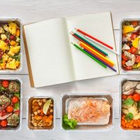 Plain book with food in cartons