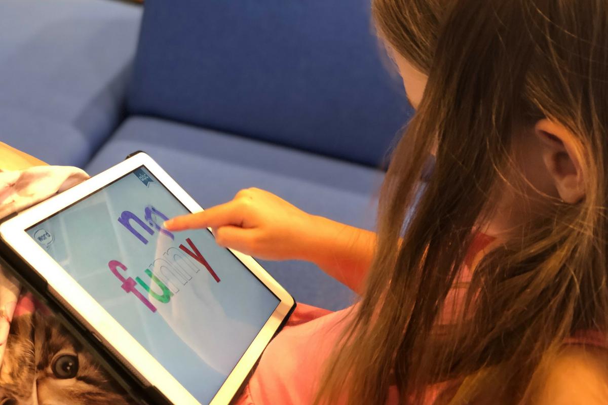 Child playing iPad