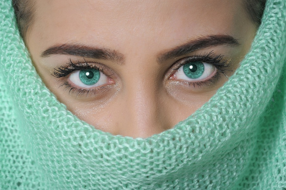 Green jumper wearing woman with green eyes