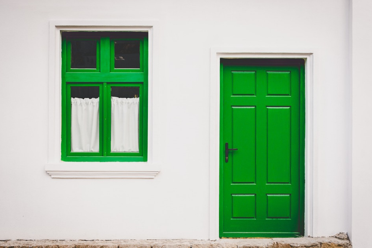 Front of a house with a green door