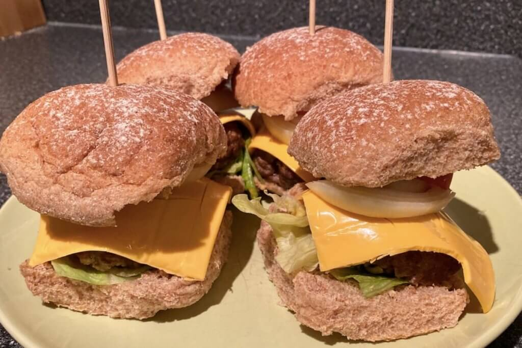 Two homemade burgers with cheese and salad