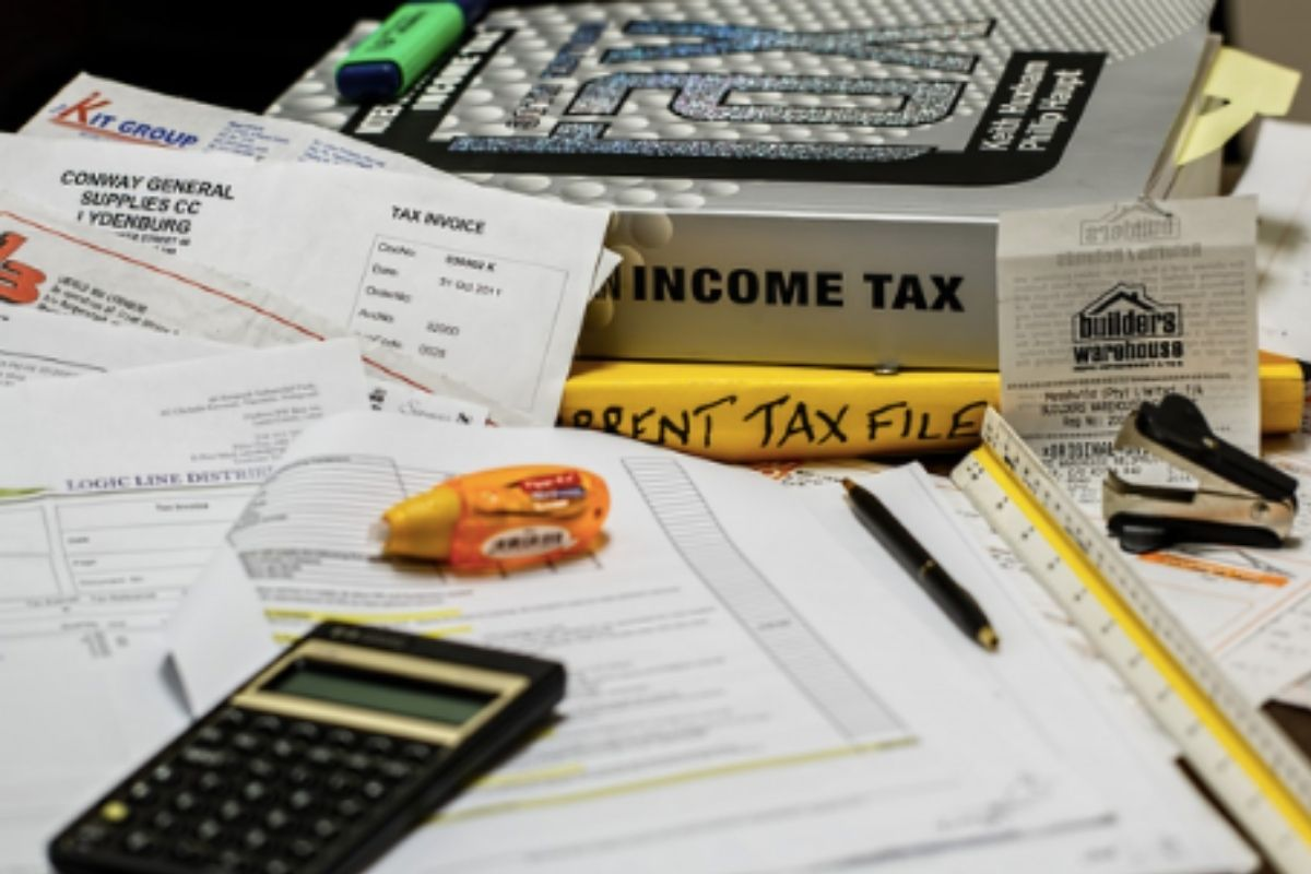 Tax papers with a laptop