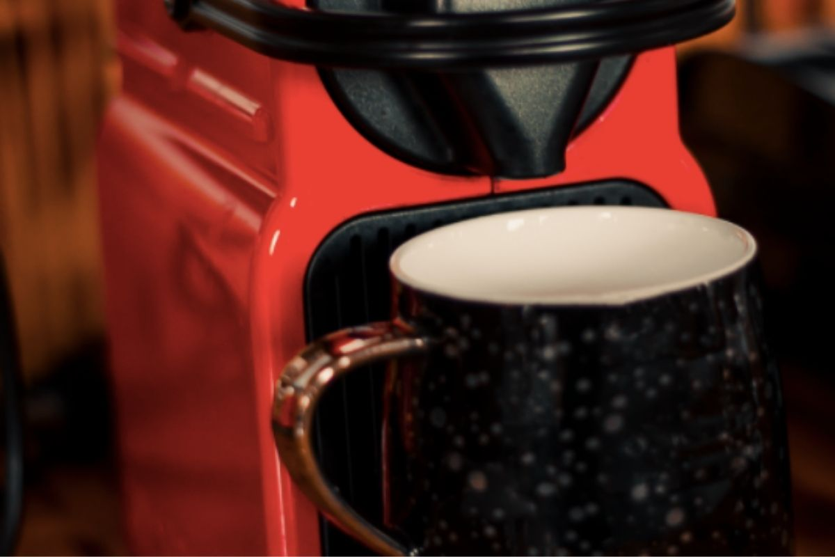 Red coffee maker with mug