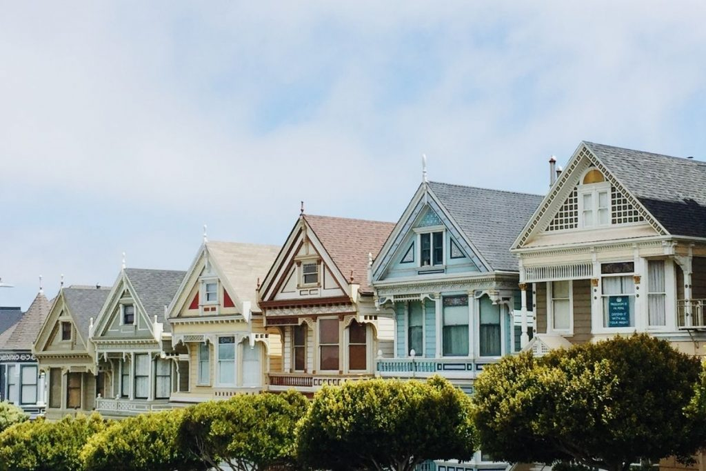 Four different coloured houses