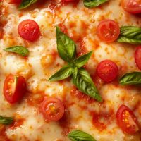 Pizza with cheese and tomato
