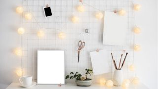 White background with lights hung up