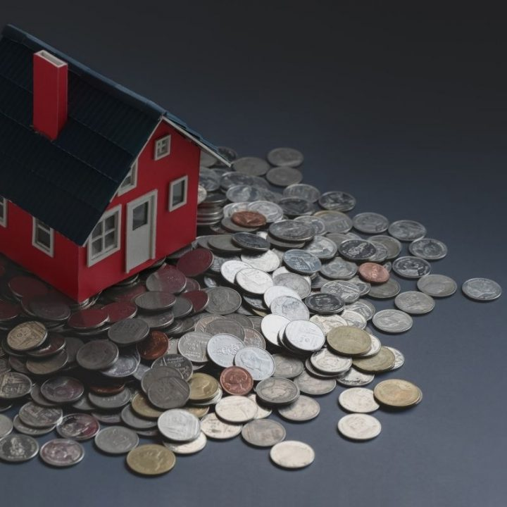Red small house sat on coins