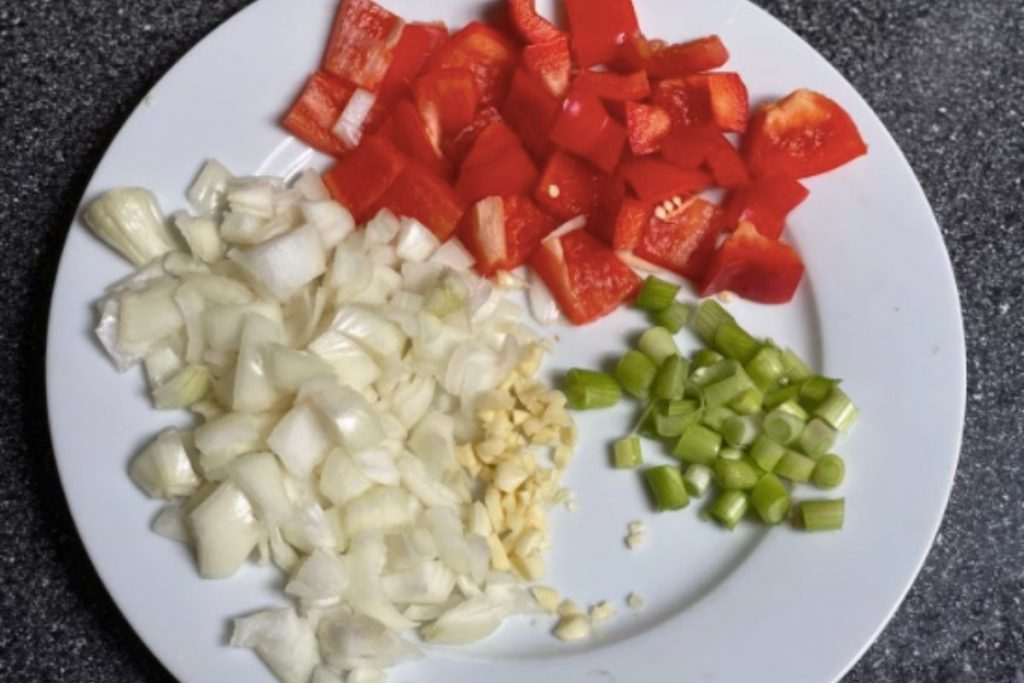 Onions, peppers and spring onions cut up