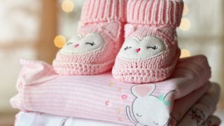 Blankets with pink booties on top