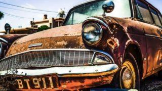 Golden car that looks rusty