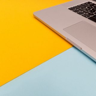 Yellow and blue desk with a laptop on