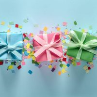 blue background with different colour boxed presents