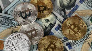 Coins on doller bills